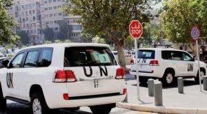 Vehículos de Naciones Unidas salen de hotel Four Seasons de Damasco, Siria, el jueves