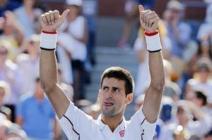 El serbio y número uno mundial Novak Djokovic celebra tras vencer al francés Paul-Henri Mathieu en partido de segunda ronda del Abierto de Estados Unidos, en el USTA Billie Jean King National Tennis Center en Flushing Meadows, Nueva York el 28 de agosto de 2014 (AFP